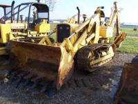 For sale is a John Deere 450 crawler loader with