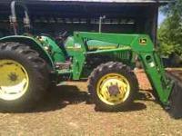 1997 John deere 5400 tractor w/ J.d. 540 loader.