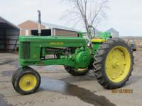 John Deere 50, always sheded and run great. $3000.00