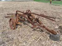 John Deere #52 pull type plow in real nice condition.