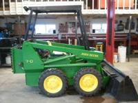 For sale is a John Deere Skidloader, has a brand new