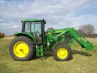 This is a 7230 John Deere Tractor SN: L and a 741
