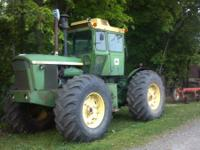 John Deere 7520 1973 model 4 wheel drive runs good...