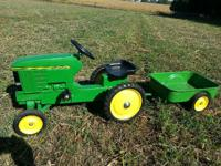 John Deere 7600 wide front pedal tractor and trailer.