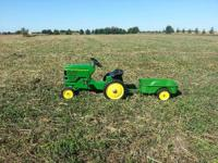 John Deere 7600 wide front pedal tractor and trailer..
