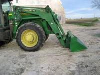 This is a John Deere 840 front end loader that comes