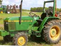 John Deere 870 tractor. It is a diesel 4 wheel drive,