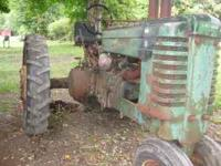 1944 John Deere Tractor with side wheel for starting.
