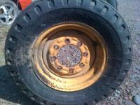 For sale is a John Deere Backhoe front tire and