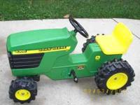 I HAVE AN ALMOST NEW KID'S JOHN DEERE PEDAL TRACTOR. IT