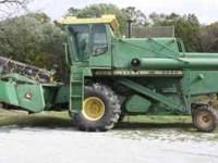This is a 6600 John Deere combine that has been shedded