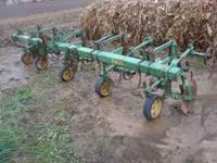 Model RM, 4 row wide cultivator. 3 point mount. Dual