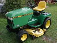 "Late 80s, early 90s John Deere Garden tractor. 48"" deck"