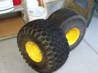 John Deere gator tires and rims. One tire leaks air one