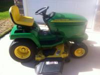 2005 John Deere GX335 garden tractor. Features a 20hp