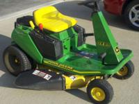 For sale: John Deere GX85 riding mower. 13 hp