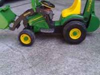 John Deere Kids Tractor (with battery charger). My kids
