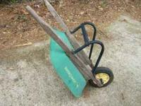 A John Deere kids wheelbarrow. Made of steel. Paint is