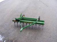 for sale is a John Deere lawn thatcher in great shape