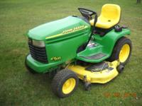 JOHN DEERE GT235 IN GREAT SHAPE . HAS A 18 HP BRIGGS