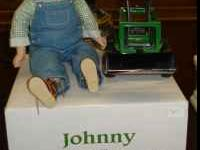 This is a very cute lil guy. It is made by John Deere &