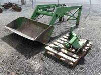 Here's a good John Deere # 47 loader attachment. Will