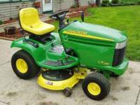 This is a used 2002 JD LX266 rider with 279 hours on it