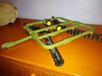 Selling great John Deere toy. Hooks to John Deere toy