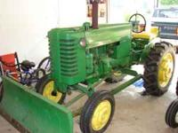 1952 jd for sale.Comes w/front plow and