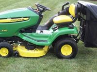 "John Deere 2009 X300 with a 42"" mowing deck and 7"