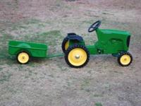 Selling a John Deere pedal tractor and wagon. The set