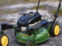John Deere Push Mower with Front wheel swivel casters.