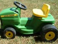 John Deere that a toddler can ride on. This is a push