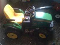 This is a John Deere Riding Kids Tractor. It would be a