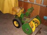 For sale a john deere snoblower with the cab on it.