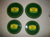 I have a set of 4 JOHN DEERE stove covers: 2 big, 2