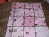 Pink/Brown John Deere Throw asking $25. Please call or