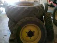 John deere set of tires and rims front tires 2 months