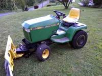 DEERE COMES WITH PLOW, DECK, WEIGHTS, CHAINS. RUNS