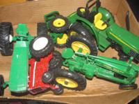 John Deere Tractor collectibles $15.00 each.  Come by