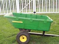 John Deere 10p utility cart . Pulls behind a lawnmower.