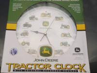 THIS CLOCK IS NEW IN BOX. JOHN DEERE WALL CLOCK. MODEL