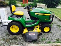 "John Deere X500 with less than 212 Hrs.  52"" Deck,"