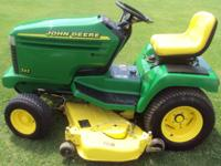 You are looking at a John Deere 325 with only 190