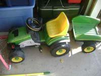 This is a John Deer Tractor. Peadle one. Has the