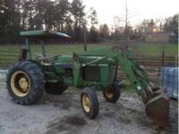 2wd 55hp tractor with loader. Has rear remote. Showing