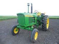 This is a 2510 John Deere gas tractor. Hour meter