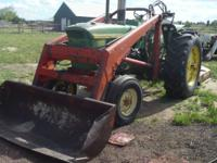 John Deere 3020 with 4 cylinder gas engin , 8 forward