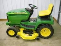 "John Deere 325 Lawn Tractor with a 48"" mower deck. 18"