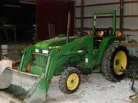 John Deere 870 4x4 compact utility tractor with a John